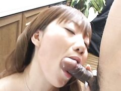 Asian girlfriend stops washing up and gives blowjob