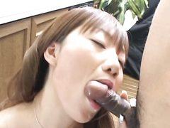 Asian girlfriend stops washing up and gives blowjob