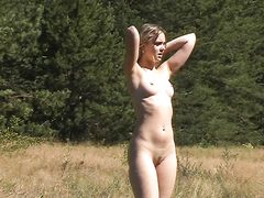Outdoor young babe swims and poses naked