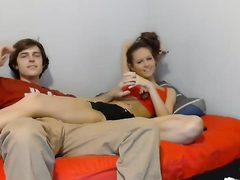 Sweet couple of teens are talking on cam
